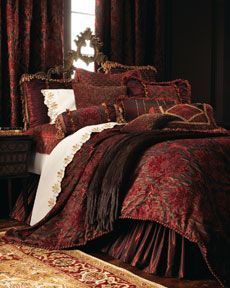 If I go for red again........I do have a red bedspread like this. I like how the brown works....do I take the blue out of my room and make changes!!! Bless my husband for putting up with me