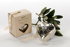 Beautifully boxed, this polished metal 'silver' heart with its satin hanging ribbon from Branche d'Olive makes a perfect present or special treat.  Hang in your wardrobe, dressing room, cloakroom or maybe your Christmas tree and the fresh, flowery rose and violet  with velvet-soft musk and sandalwood will delight you. The fragrance should last for up to 6 months after which the heart may filled with pot pourri of your choice.