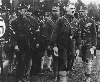 Adolf Hitler mingles with Nazi storm troopers during the 1927 Nuremberg rally.