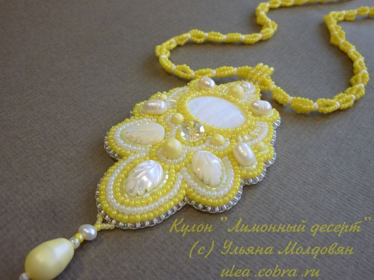 Handmade bead embroidery pendant. Beaded jewelry. Yellow and white.