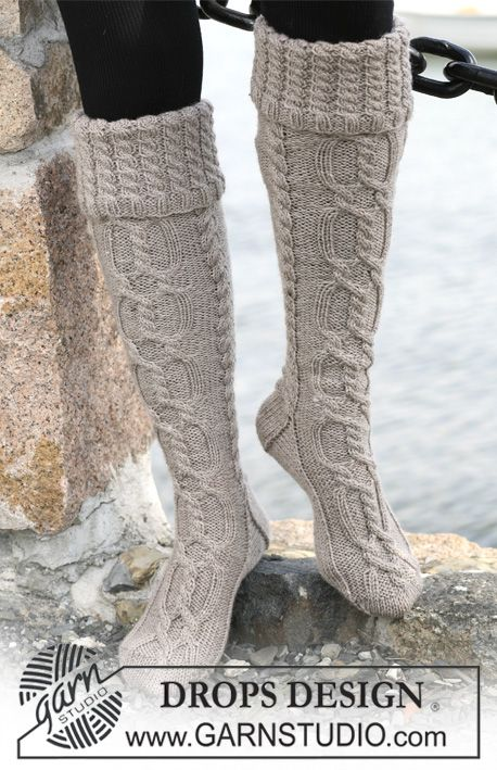 "Long DROPS socks in ""Karisma Superwash"" with cables and folded edge. ~ DROPS Design  Love! I am obsessed with boot socks right now. Want to knit every single one!"