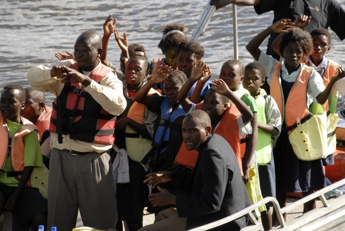 On Wednesday 13th March at 16:00 on the dot, 3 boats with singing and waving children arrived at Lufupa Camp, Zambia