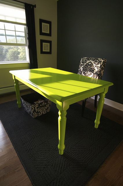 Wonder if I could paint my solid wood dining table like this.     Black wall with dresser painted lime green in front of it cool.