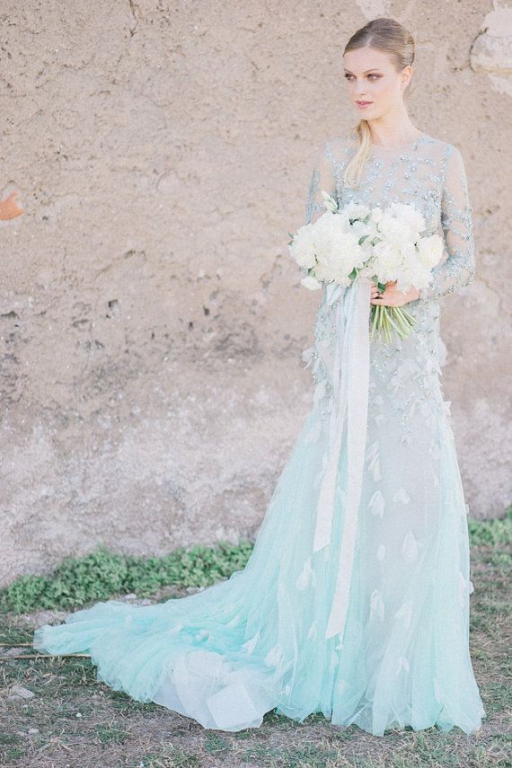 Sheer, powder-blue bridal gown with intricate beadwork