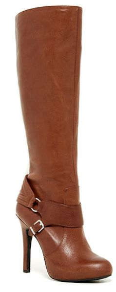 High heeled brown leather boots