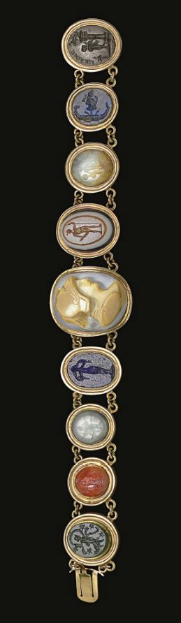 A BRACELET OF NINE ROMAN RINGSTONES   CIRCA 1ST-2ND CENTURY A.D.   Mounted together in a late 19th century gold setting