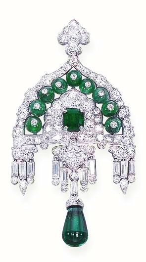AN EXQUISITE ART DECO EMERALD AND DIAMOND BROOCH Designed as an old mine-cut diamond dome of Indian motif, enhanced by emerald beads, each with a diamond collet, to the central rectangular-cut emerald, suspending a fringe of baguette and collet diamonds and drop-shaped emerald pendant (accompanied by its original drawing), 1929, in a Cartier red leather case By Cartier