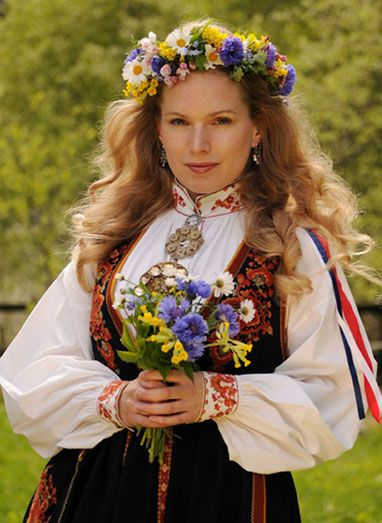 Midsommer celebration in Telemark, Norway. Like the heavy embroidery on cuffs and collar, rest white.