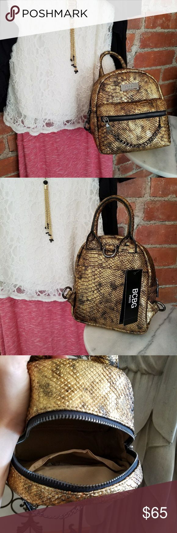 NWT BCBG Petite Backpack A petite bag,  but with plenty of room!  What a great gold color with it's hardware an unexpected gun metal gray!   So awesome! BCBG Bags Backpacks