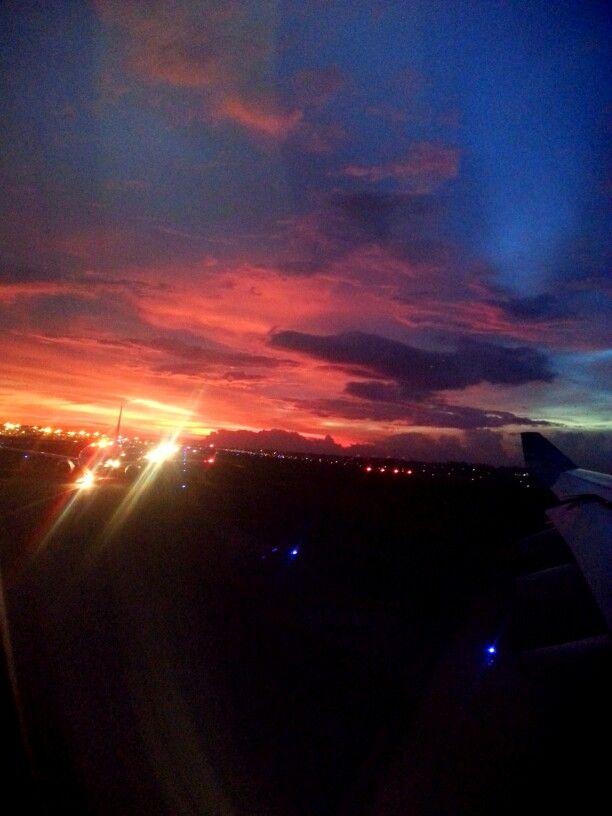 Sunset skies at airport.. red yellow orange blue black