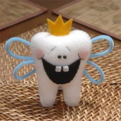 This Tooth Fairy Pillow Pal by Simply Sweet Gifts is sure to glean a toothy grin from any child.