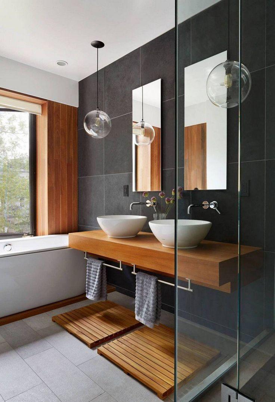 meuble sous vasque en bois massif, carrelage sol gris et baignoire encastrée