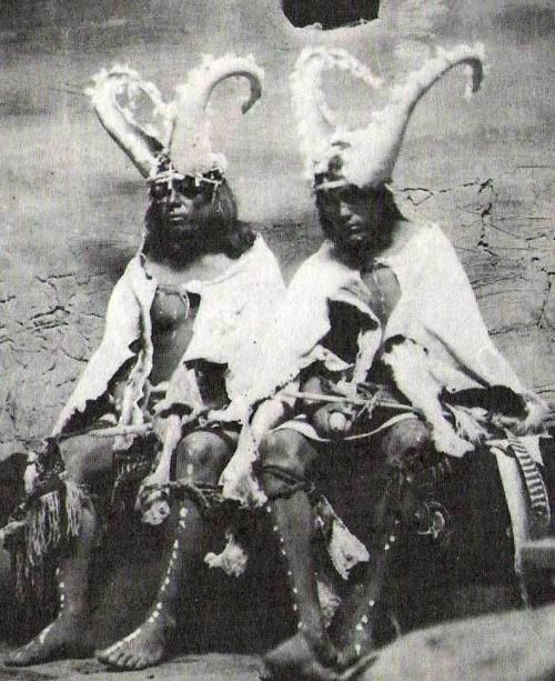 Two priests of the Hopi Two Horn Society (representing the extra-terrestrials, keepers of the balance of the stars, sun, sky, and moon, and protectors and guardians of human life and everything on earth. Intermediaries between the living and the dead.)