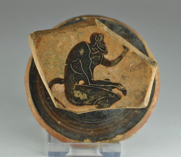 Greek attic black-figure vase, Minotaur on Athenian kylix, 470- 460 B.C. Greek attic black-figure vase, the figure is well rendered with incised detail, in Greek mythology the Minotaur  was a creature with the head of a bull and the body of a man or, as described by Roman poet Ovid, a being part man and part bull. The Minotaur dwelt at the center of the Labyrinth designed by architect Daedalus and his son Icarus, on the command of King Minos of Crete, 8 cm wide. Private collection