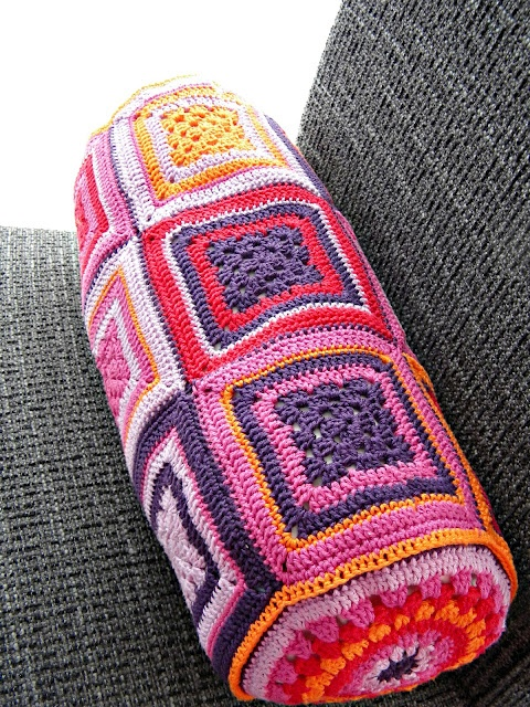 crocheted bolster cushion, using granny squares and granny circles at ends