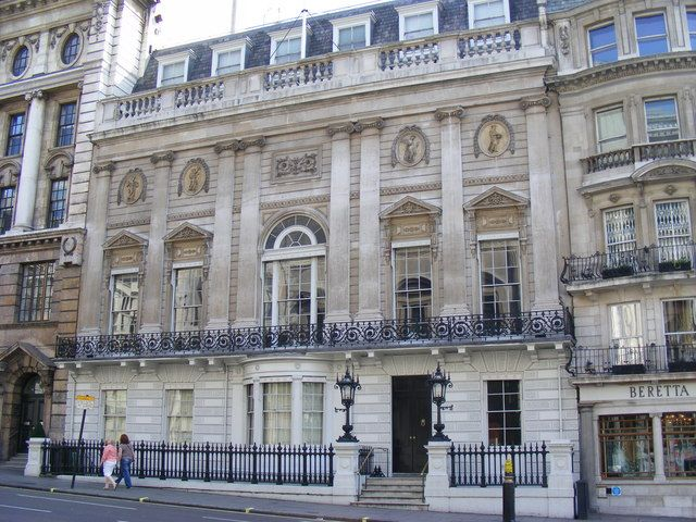 White's mens' club in London, where Regency dandies like Beau Brummel gatheredin the famous bow window. Ryan had to pass muster at White's if he was going to be believed in his role/disguise as a fop.
