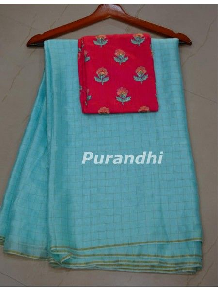 8c11087ac5a37 Checks Jute silk saree paired up with Contrast embroidery worked blouse