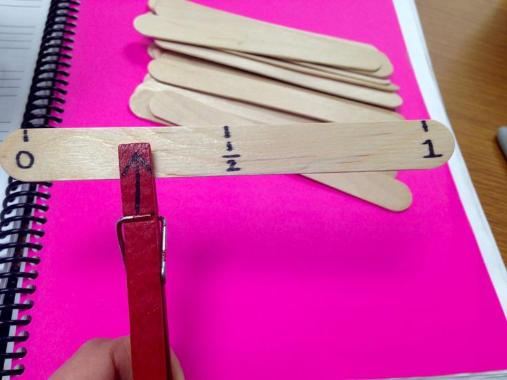 Teaching Benchmark Fractions with Popsicle sticks and clothespins
