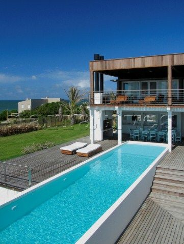 Holiday home exterior with swimming pool and balcony terrace
