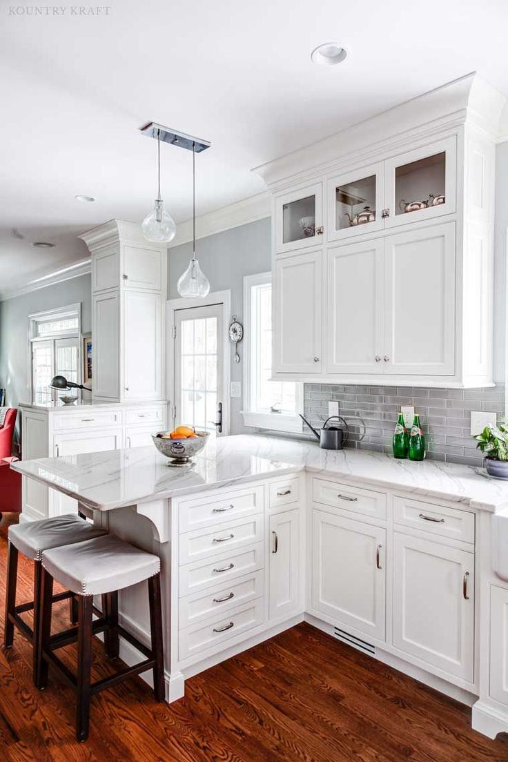 Custom White Shaker Cabinets for a white and gray transitional kitchen  design by Justin Sachs of Stonington Cabinetry & Design.