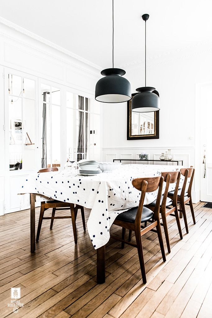 Mid-century modern black and white monochromatic dining room style: love the wood and black leather chairs paired with the black pendant lamps over the dining table, with the polka dot tablecloth adding a bit of fun to the whole look. Love!