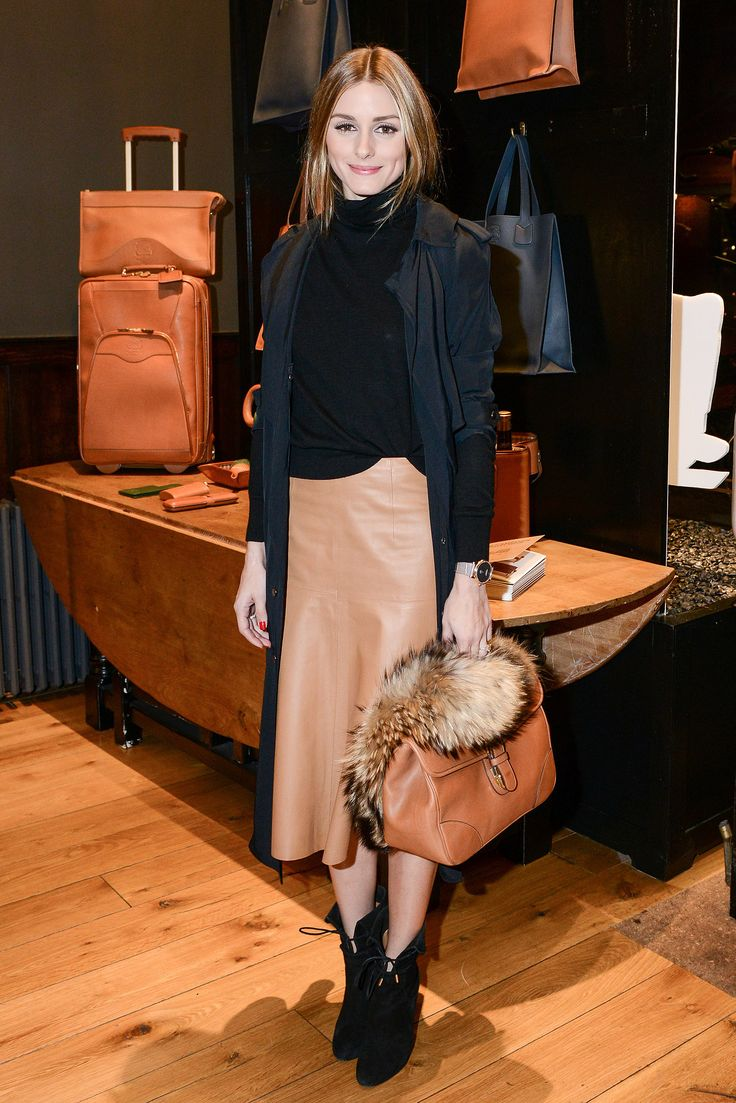 Olivia Palermo off the hair tuck with a turtleneck.