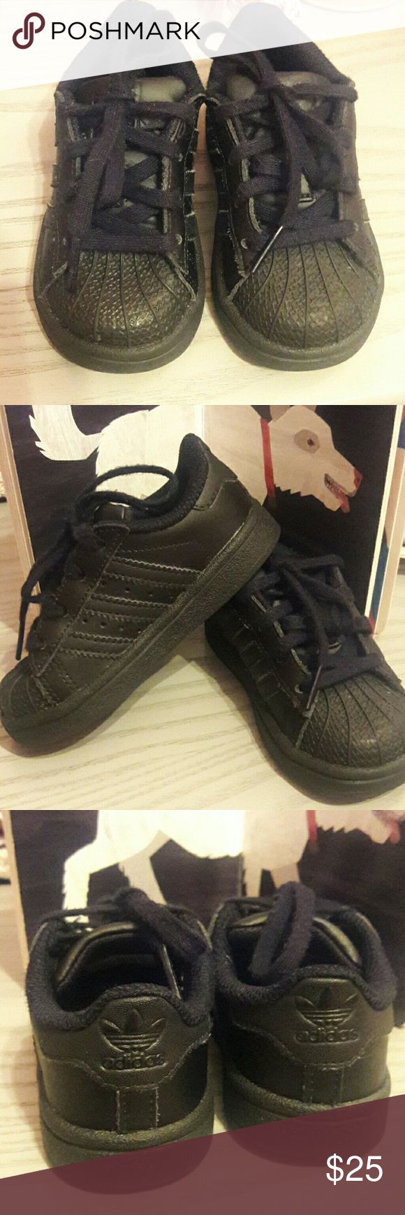 Black Shell toe Adidas Definitely a classic...all black shell toe Adidas in good condition universal shoe can be worn by boys or girls...they seem to run big adidas Shoes Sneakers