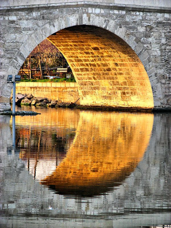 Reflective bridge circle... wonderful pic... Reflections draw the circle, sunbeams, water, bricks, architechture, beauty, photo