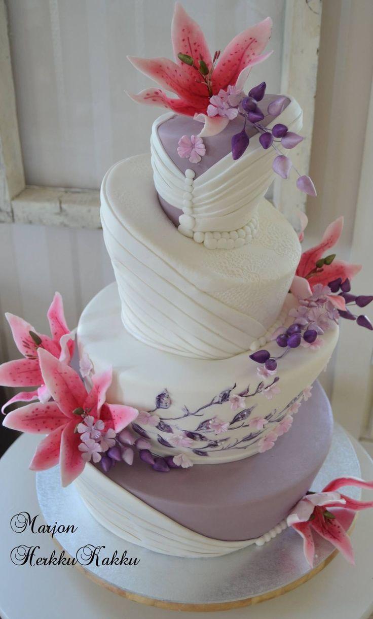 Purple topsy turvy wedding cake
