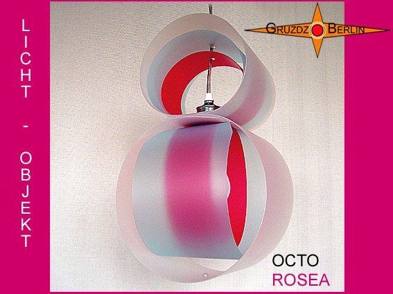 Leuchte OCTO ROSEA Pendellampe mit Baldachin. Eine Acht in Pink und zartem Blau: Die Pendelleuchte OCTO ROSEA mit passendem Baldachin erzeugt durch die Kombination der Farben ein dem Tageslicht ähnliche Lichtfarbe. Die einzelnen Farblagen sind beweglich und können individuell verstellt werden.