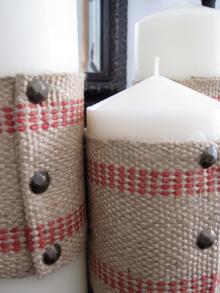 Cute burlap wrapped candles with upholstery tacks.