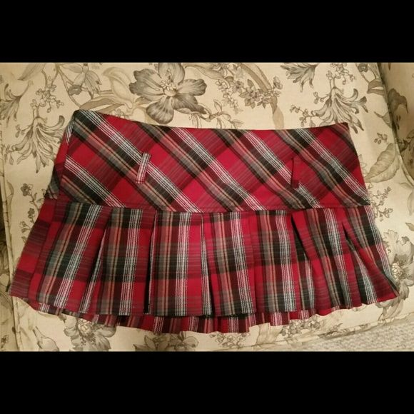 Red tartan micro skirt Pleated red tartan micro (super short on me, 5'6 with a bit of a booty) with belt loops and zipper in back. Great condition! Perfect for school girl costumes for Halloween or go-go dancing! Or a club outfit if you're daring ;) Charlotte Russe Skirts