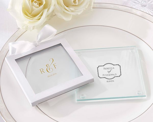Give your wedding guests a cherished memento with Kate Aspen's personalized glass coasters, available in two classic designs for an elegant wedding favor.