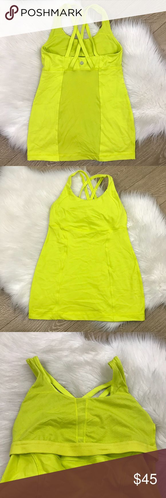"""Lululemon Neon Yellow Strappy Yoga Tank Top Strappy Tank by Lululemon  • Size 4  • Bust: 24"""" Full Length: 23""""  • In excellent condition; never been worn.  • Save 10% on bundles of 2 or more items lululemon athletica Tops Tank Tops"""