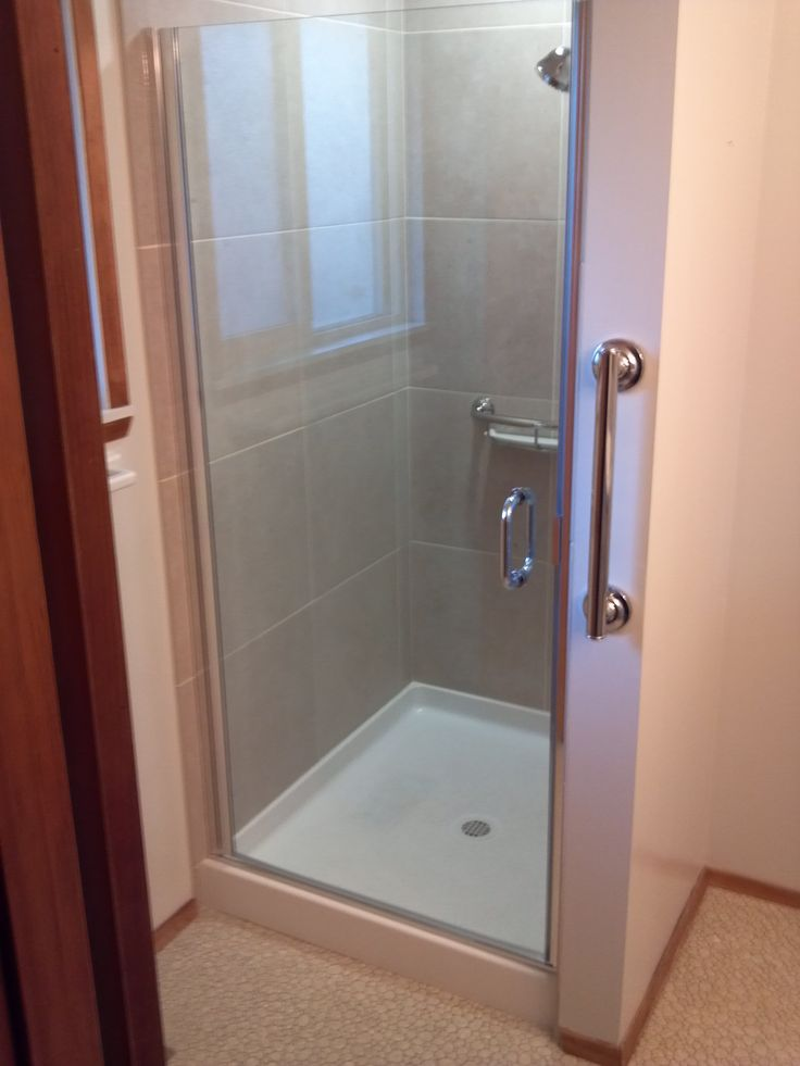 make the most of a small space with a corner shower http