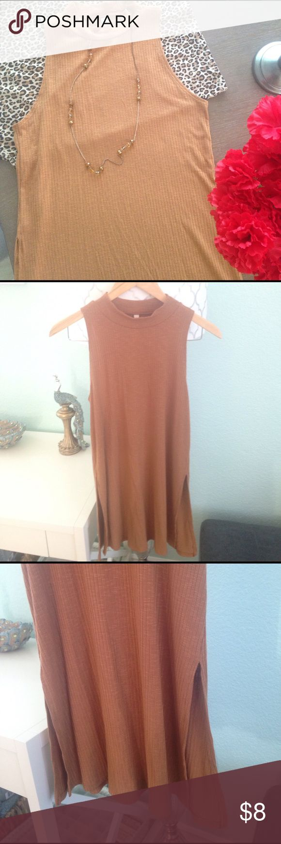 Camel colored high neck sleeveless tunic This tunic looks fabulous with leggings under a jacket or kimono . The camel color is gorgeous. Soft material. High slit openings on the bottom sides that might show some midriff if you have long torso. No size on tag but fits like M Tops Tunics