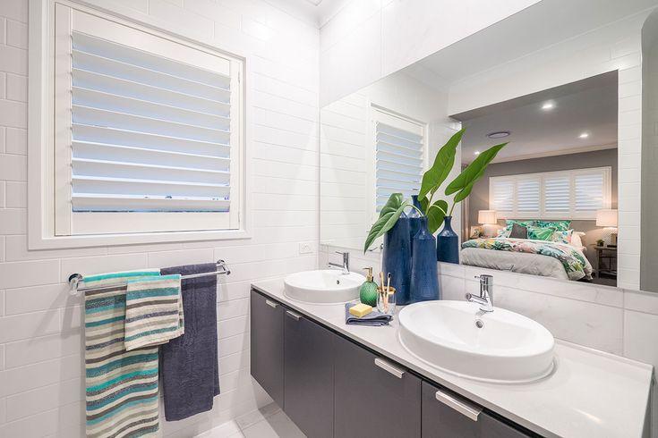 Ensuite. Tropical. White shutter window. Double sink basin.