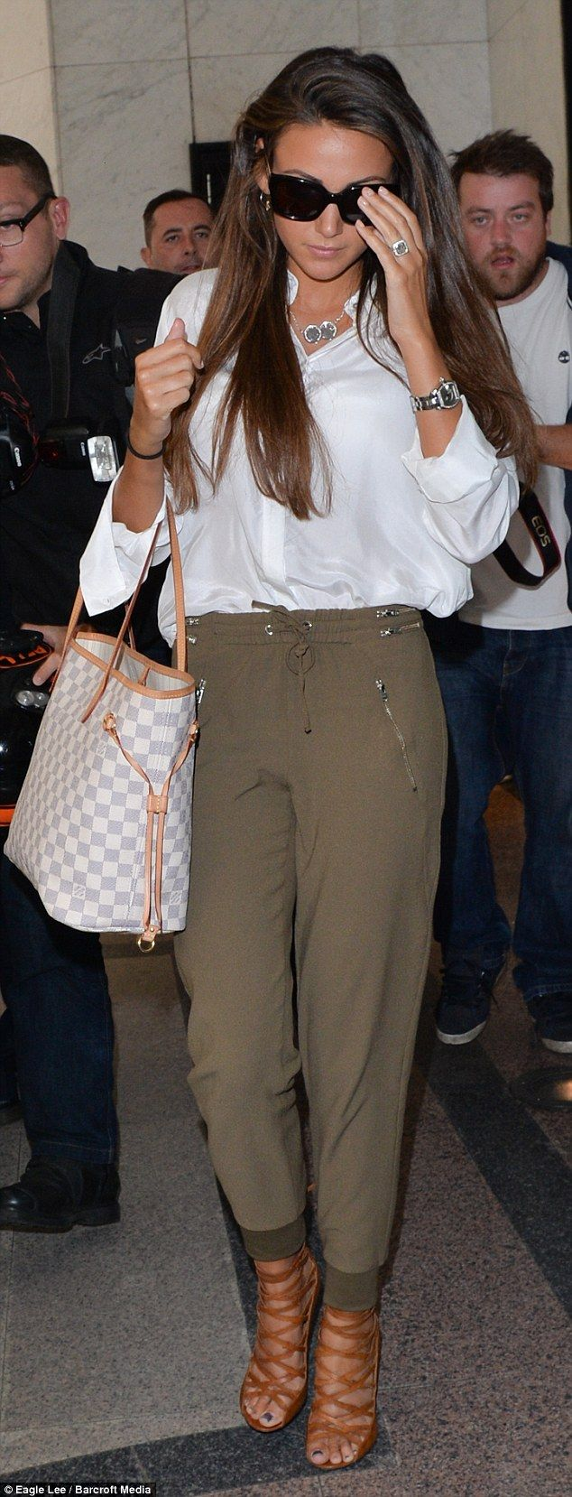 Cool and comfy: The 27-year-old wore a white shirt and khaki tapered trousers