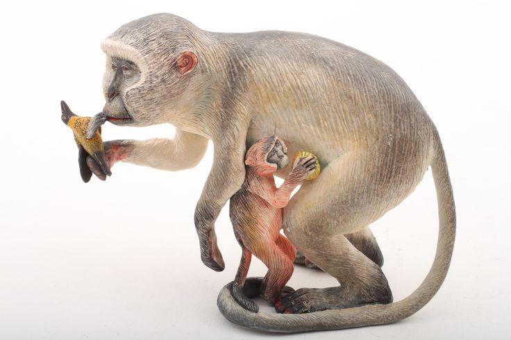 Monkey Kissing Bird Sculpture