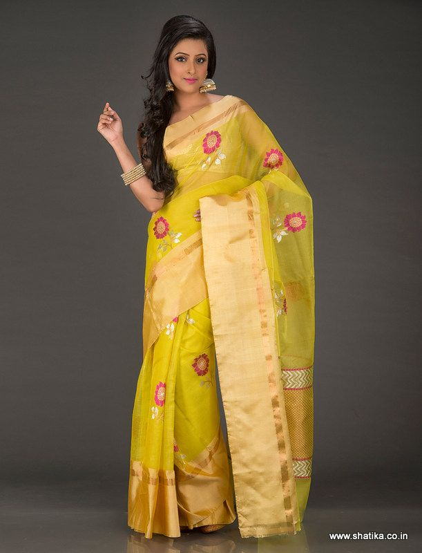 Like the radiating Patali flowers spread their charm on spring mornings, so do they on the Patali Lime Yellow with Bold Flower Motifs Real Zari Kota Doria Saree. Each flower motif standing out crisp and clear in fiery pink thread and pure zari work, they make sure you blossom whereever you go. The plain broad gold border adds sparkle to this spirited Kota saree.