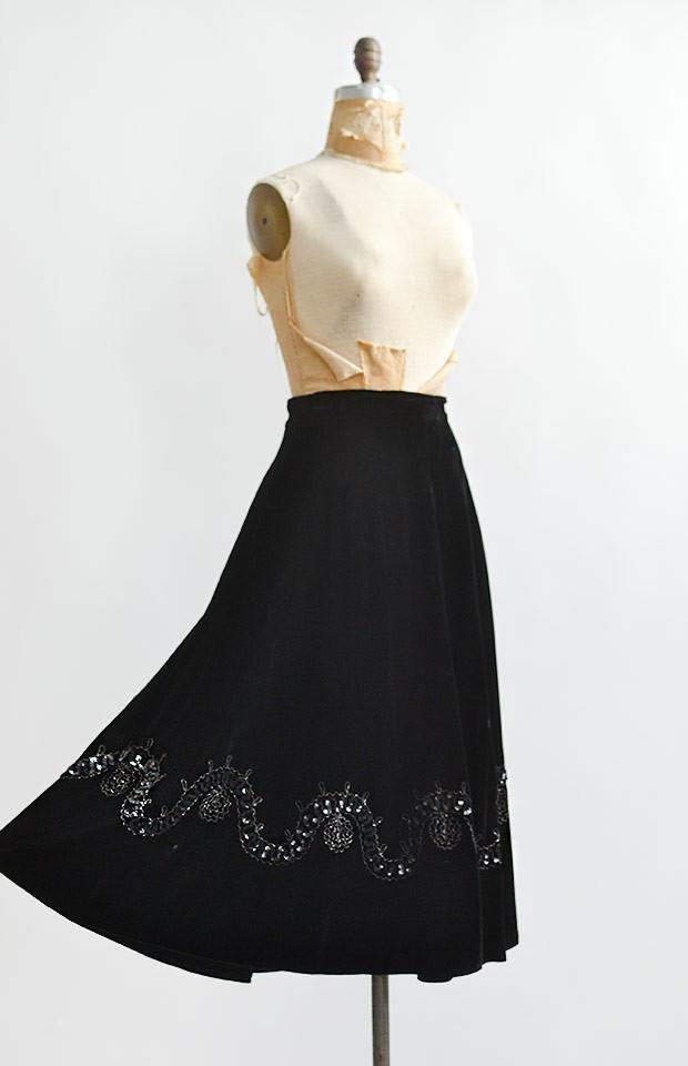 "Vintage 1940s ""Ungar, A Madalyn Miller Original"" black silk velvet a-line skirt with wonderful swishy movement. This vintage skirt has appliqué and black sequined detail bordering near the hem. Unlined."