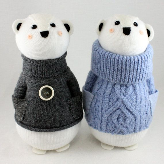 2 little Polar Bear Sock Dolls by Sewinthemoment  One wears charcoal grey and a vintage button The other wears an upcycled wool sweater that has been felted.