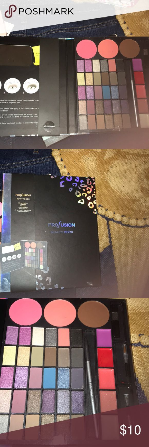 Beauty book Profusion beauty book. Comes with 30 eyeshadows, 2 blushes, 1 bronzer, 1 eye liner pencil, 5 lip glosses, 2 eye shadow applicators, & 1 blush applicator Makeup Eyeshadow