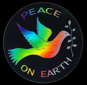 A colorful dove carrying a fig and peace on earth written in background