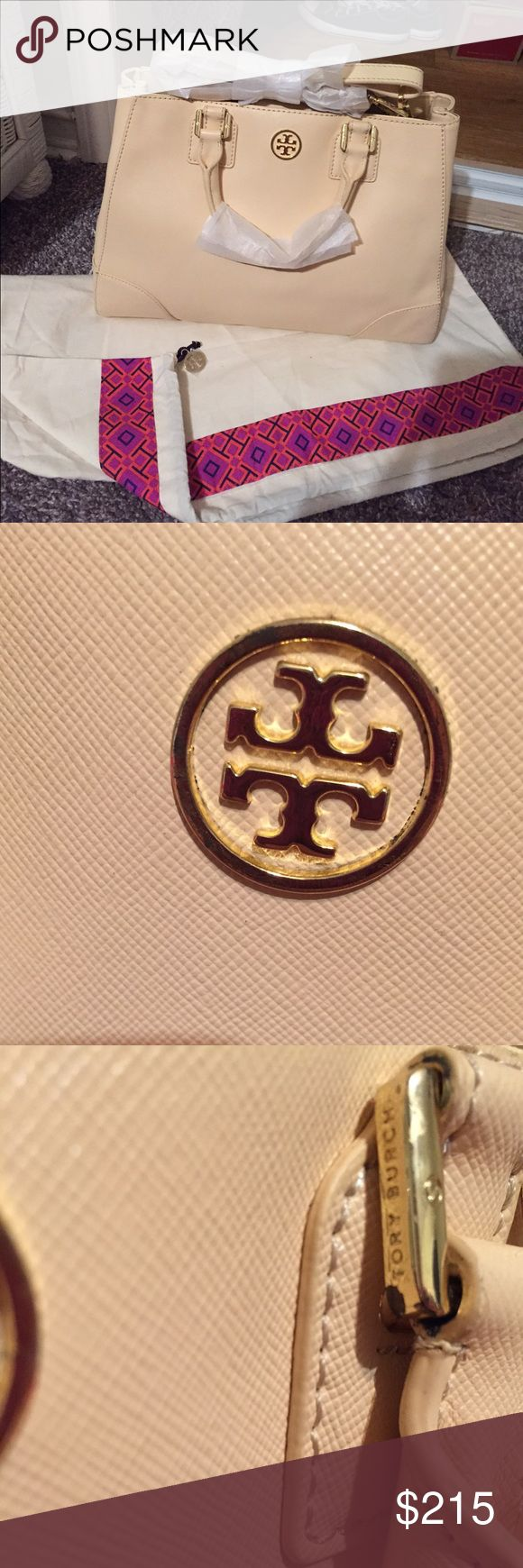 Tory Burch -2010 Collection Triangle Tote.  -There are creases in bottom and sides but not noticeable when carried. -Hardware has scratches. -Hardware has discoloration -Exterior and interior are clean. -Never used  Material is coated canvas and PVC. Length 13.5 inches. Height 9 inches. Depth 5 inches. Originally $525 plus tax.  PRICE FIRM. Ships within 1 to 2  business days. Tory Burch Bags Crossbody Bags