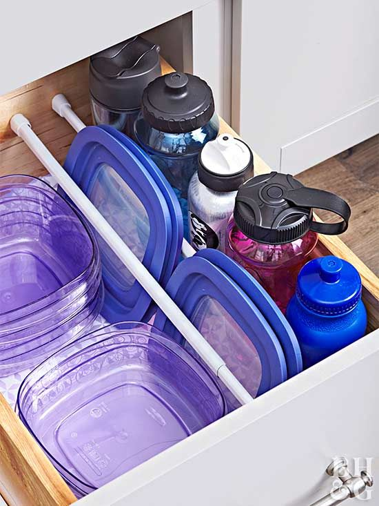 Rethink how you use tension curtain rods. Place rows of the affordable window-treatment hardware inside a cabinet to keep plastic food-container lids, baking sheets, or serving trays upright and organized.