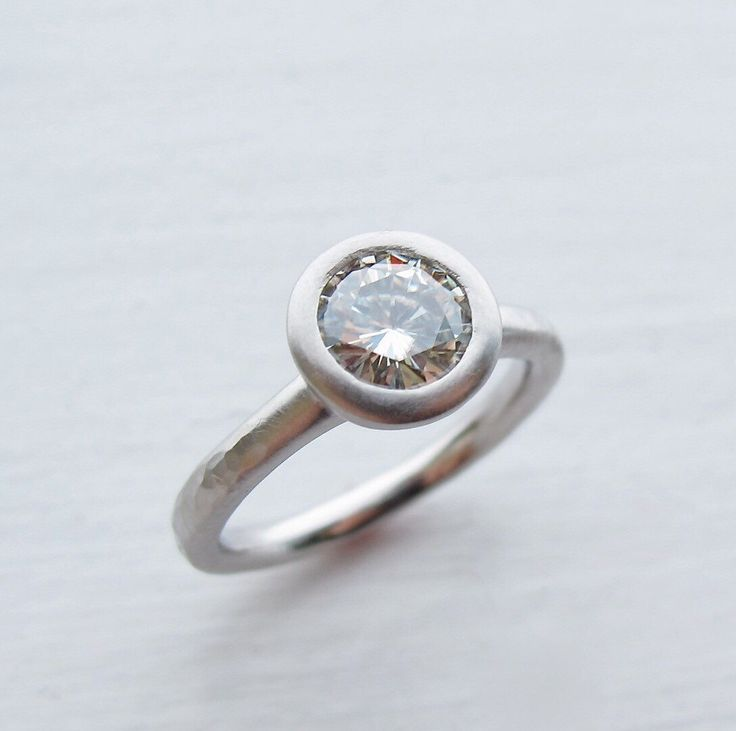 Forever One moissanite and palladium engagement ring solitaire by singleBbeautiful on Etsy https://www.etsy.com/listing/128247157/forever-one-moissanite-and-palladium