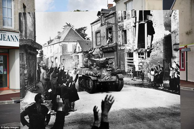 Sainte Mere Eglise, France. 1944: A French armored column passing through the small French...