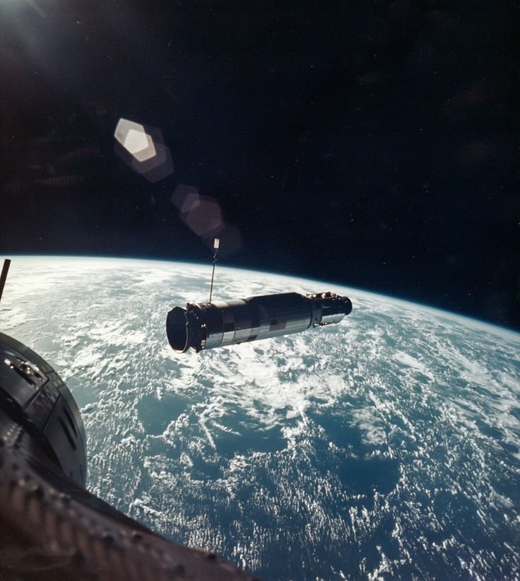 Orbital Rendezvous. One of the crucial skills NASA needed to perfect before heading to the moon was docking with another spacecraft. Here, the Gemini 10 capsule, with John Young and Michael Collins, nears the unmanned Agena spacecraft about 100 feet away.