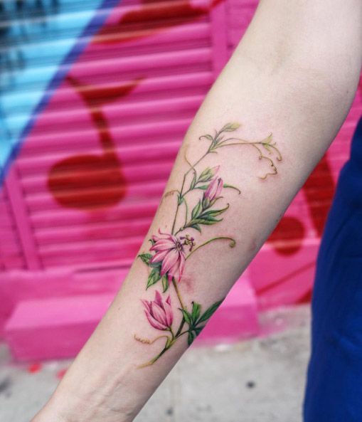 Stunning passion flower tattoo by Nando